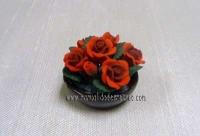 Maceta de rosas rojas -
